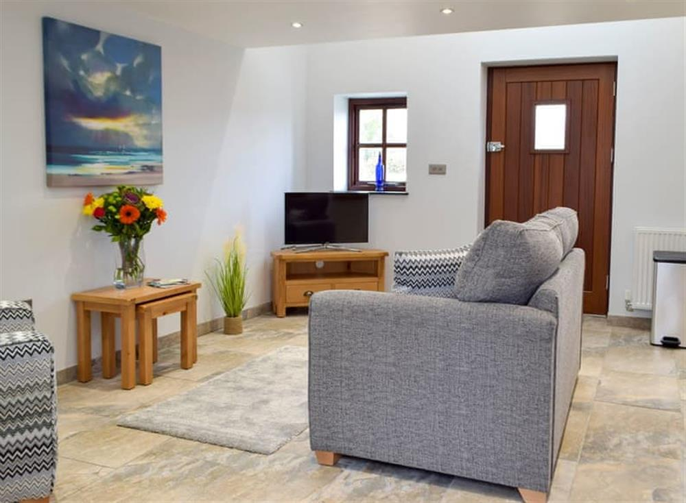 Comfortable living area at Snowdrop Cottage,