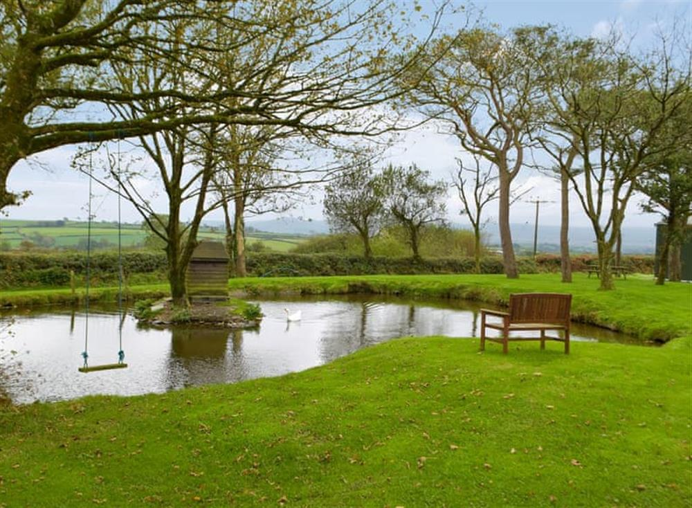 Fenced pond 10 yards from the property at Snowdrop Cottage,