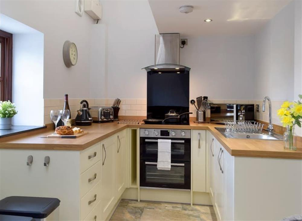 Galley style kitchen area at Snowdrop Cottage,