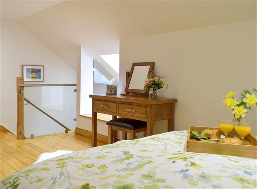 Relaxing bedroom with kingsize bed and wooden floor (photo 2) at Snowdrop Cottage,