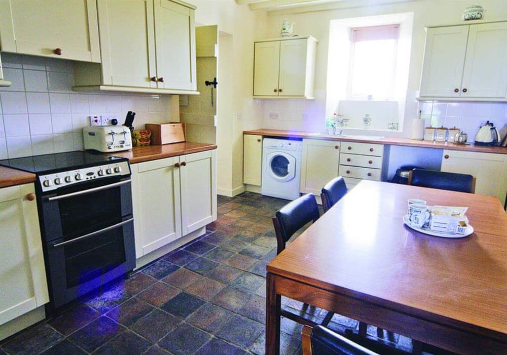 Penrhyn Mawr kitchen with dining area at Penrhyn Mawr in Pwllheli, Gwynedd