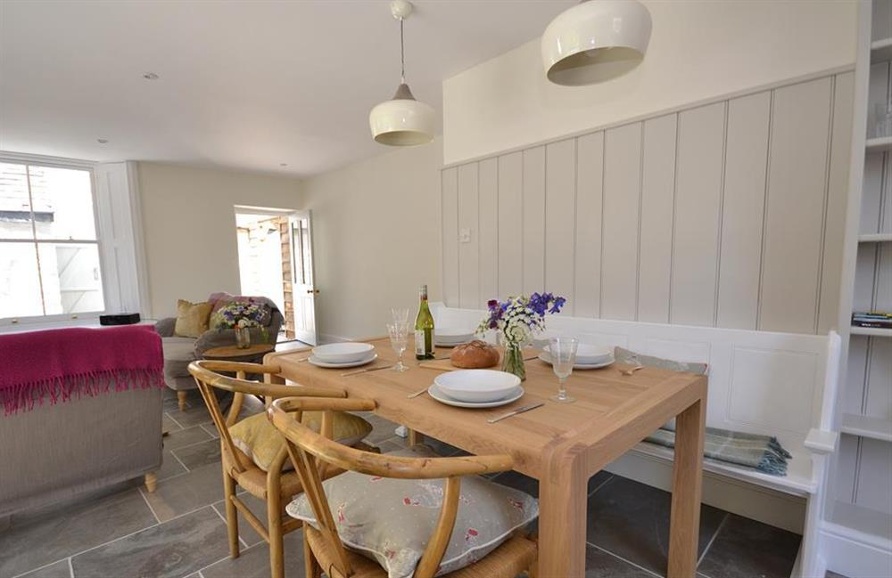 The dining table can easily seat four at Perchwood Cottage, Tuckenhay