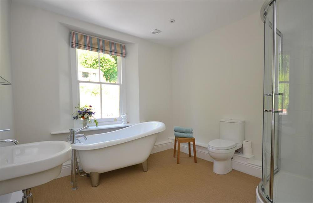 The luxury bathroom with slipper bath and separate shower at Perchwood Cottage, Tuckenhay