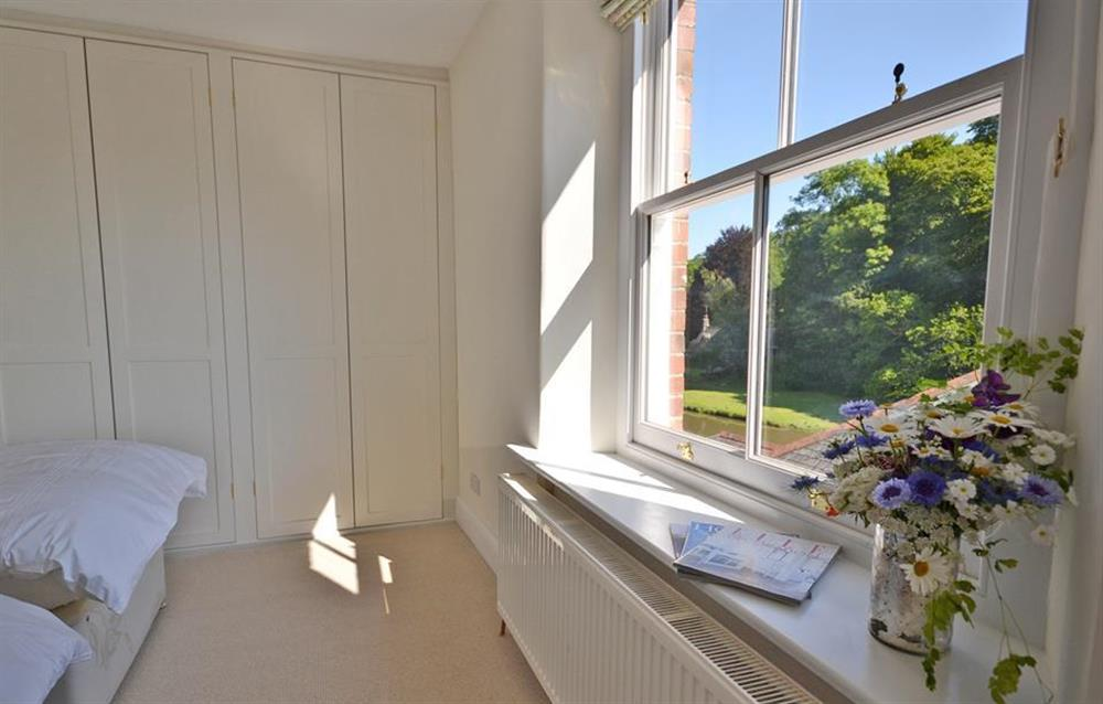 The twin bedroom enjoys glimpses of the creek at Perchwood Cottage, Tuckenhay