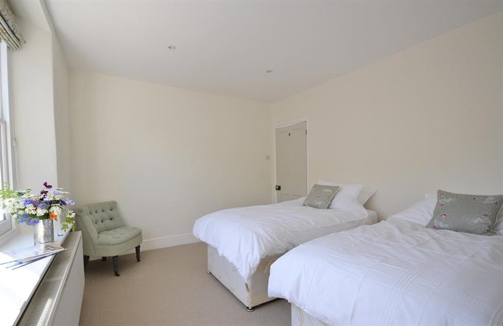 The twin bedroom - the beds can be joined to create a super king upon request at Perchwood Cottage, Tuckenhay