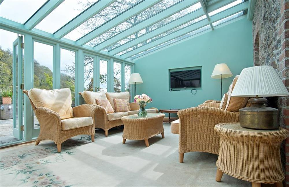 Enjoy the lovely waterside views from the conservatory at Perchwood Shippon, Tuckenhay