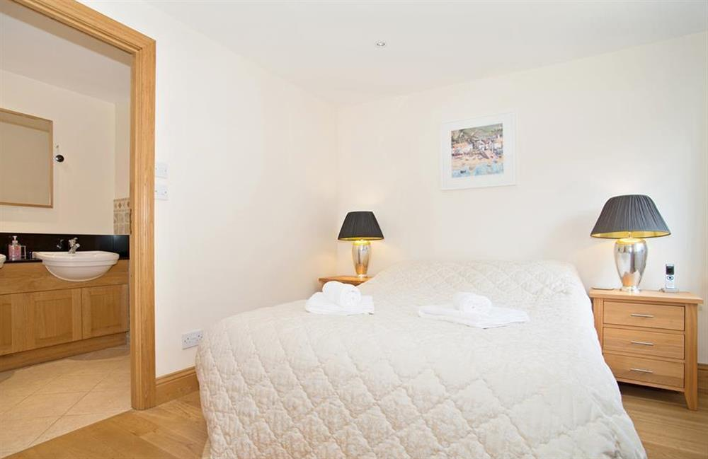 Ground floor bedroom 4 with double bed at Perchwood Shippon, Tuckenhay
