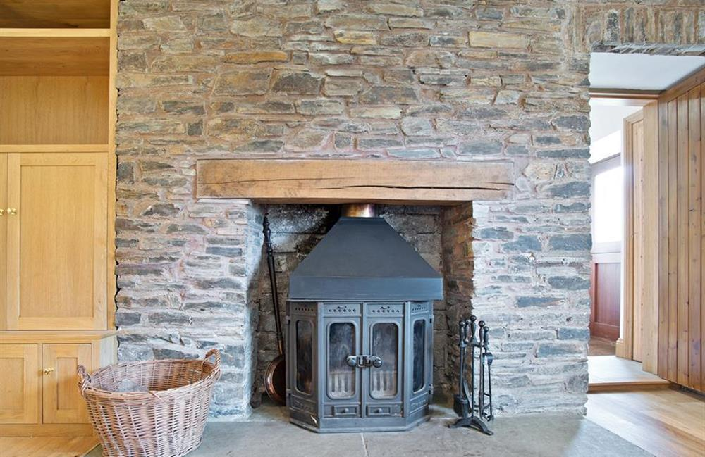 The cosy log burner, in the lounge at Perchwood Shippon, Tuckenhay