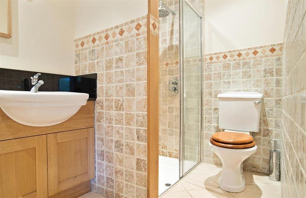 The en suite shower room to bedroom 4 at Perchwood Shippon, Tuckenhay