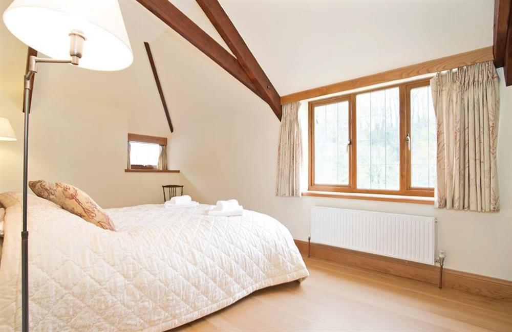 The master bedroom, with kingsize bed at Perchwood Shippon, Tuckenhay