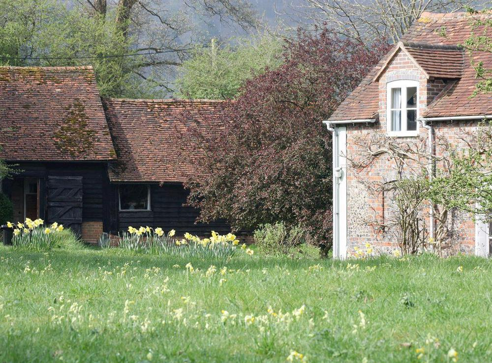 Beautifully restored former cow barn in the Buckinghamshire countryside at Pheasants Hill Old Byre in Hambleden, near Henley-on-Thames, Buckinghamshire, England