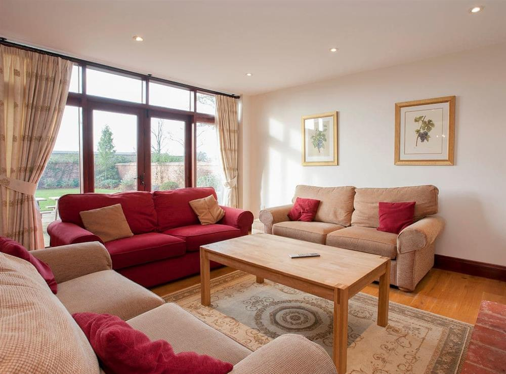 Open plan living space at Kingfisher Barn,