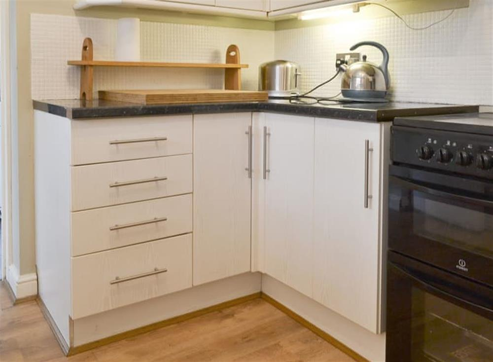 Fully appointed kitchen with utility room at Pinewood Cottage in Hainford, near Norwich, Norfolk