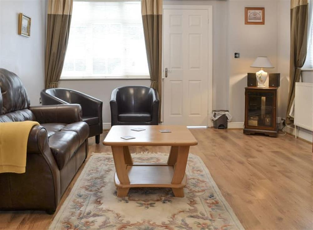 Spacious living and dining room at Pinewood Cottage in Hainford, near Norwich, Norfolk
