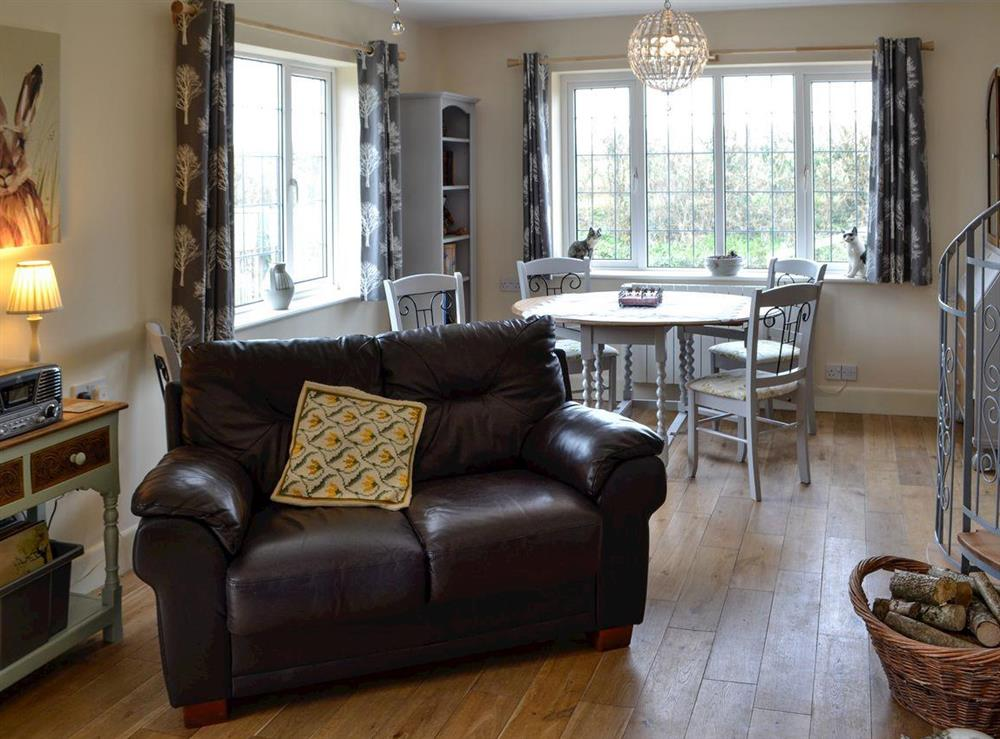 Living room with dining area at Pipers Pool in East Stour, near Gillingham, Dorset, England
