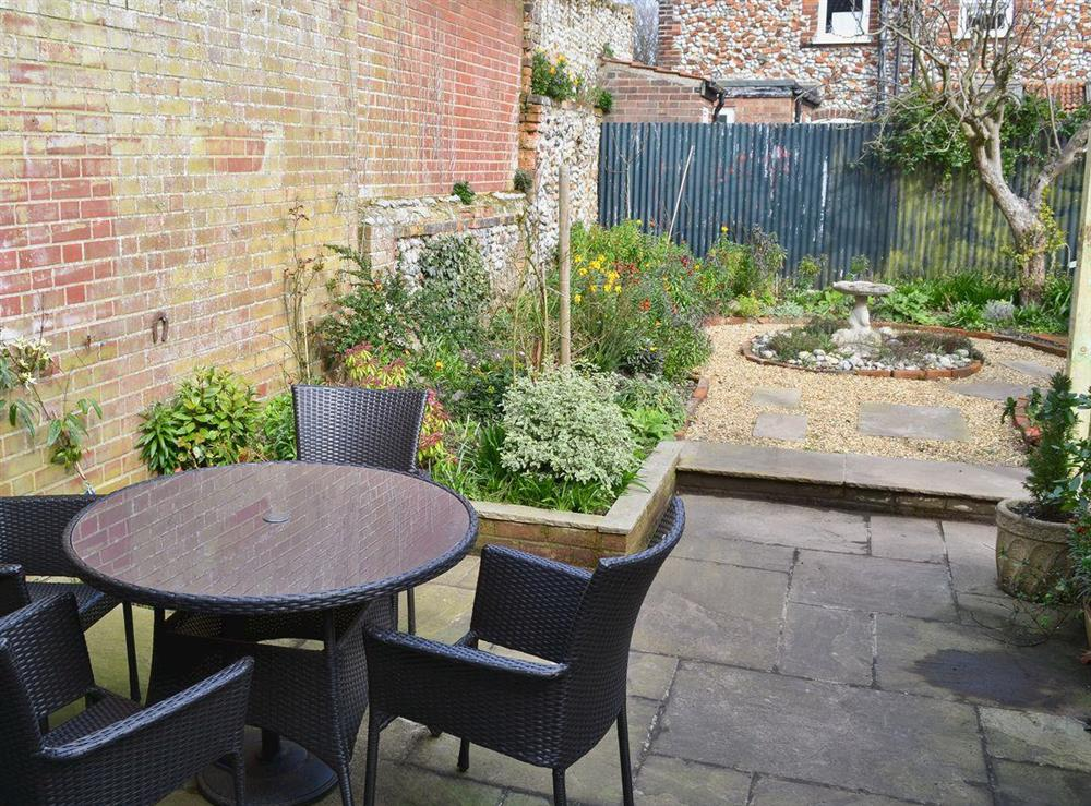 Garden & outdoor sitting area at Pippin Cottage in Holt, Norfolk