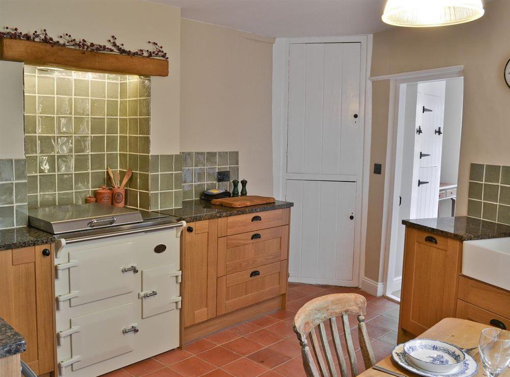 Kitchen diner with range cooker & belfast sink at Pippin Cottage in Holt, Norfolk