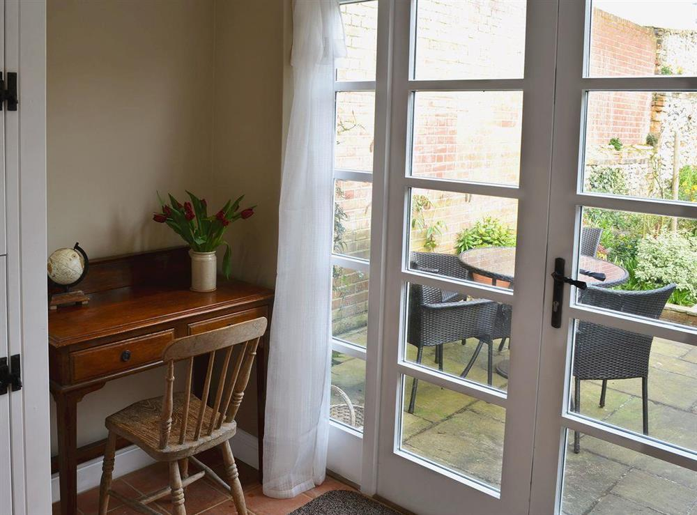 Patio doors leading to garden at Pippin Cottage in Holt, Norfolk