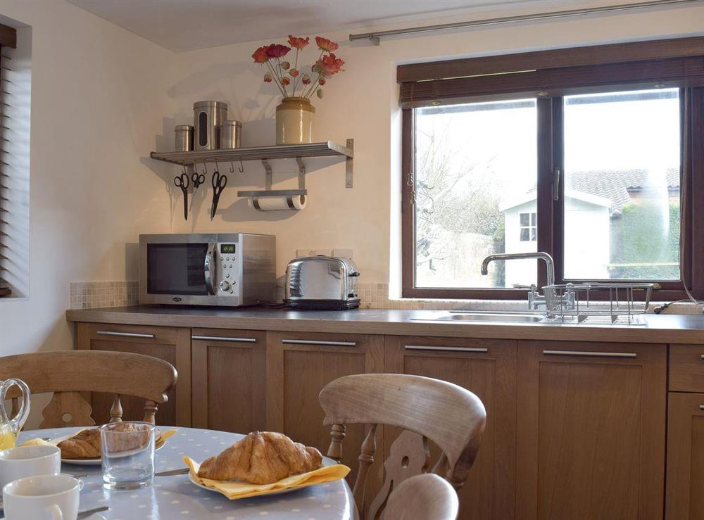 Kitchen with dining area at Pond Cottage in Somerleyton, near Lowestoft, Suffolk
