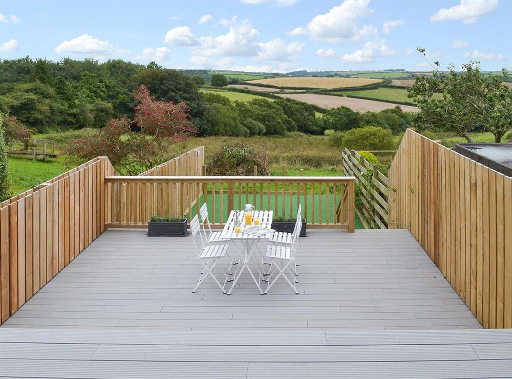 Sitting out area with stunning views at Poppy Cottage in Blackawton, near Dartmouth, Devon