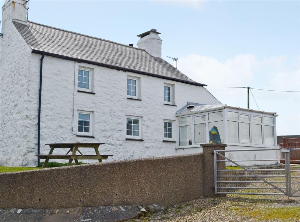 Exterior at Porth Colmon Farmhouse in Porth Colmon, near Pwllheli, Gwynedd