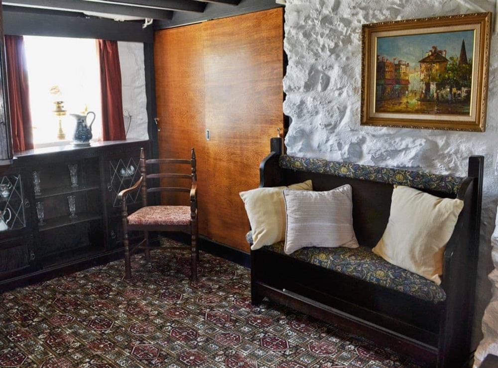 Living room/dining room at Porth Colmon Farmhouse in Porth Colmon, near Pwllheli, Gwynedd