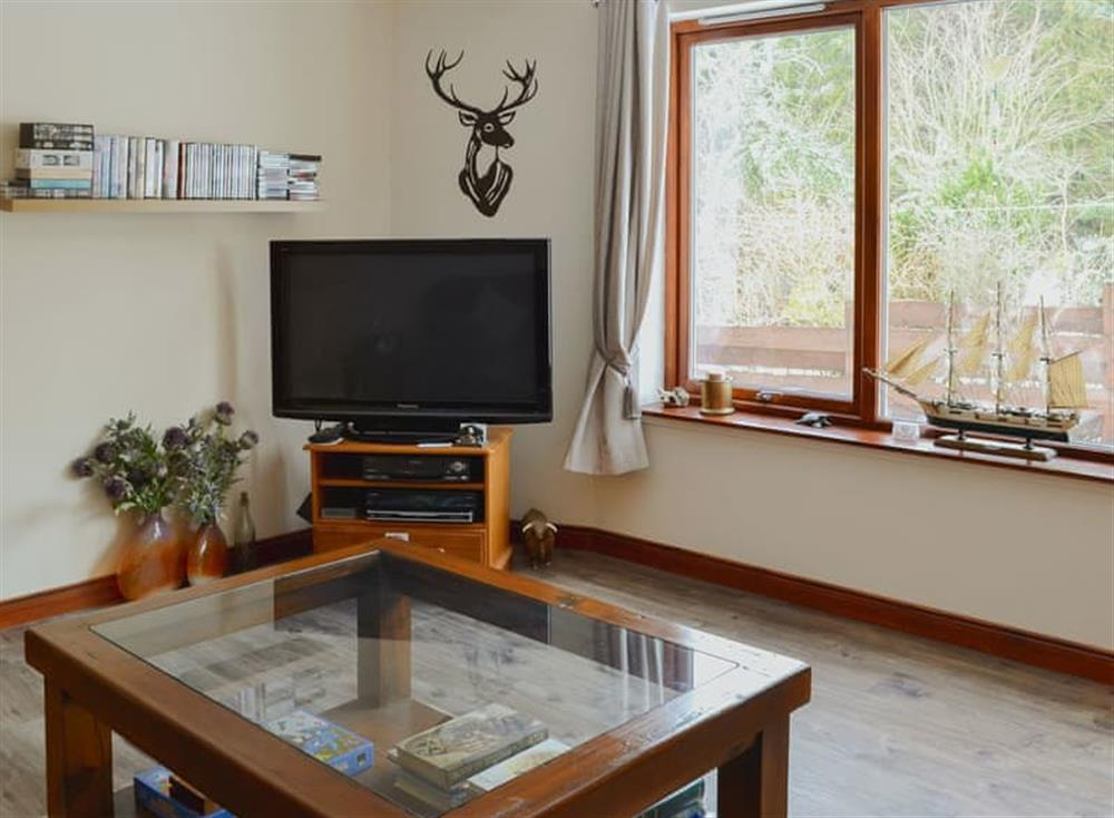 Comfortable living room (photo 2) at Post Office Cottage in Dulnain Bridge, near Grantown-on-Spey, Morayshire