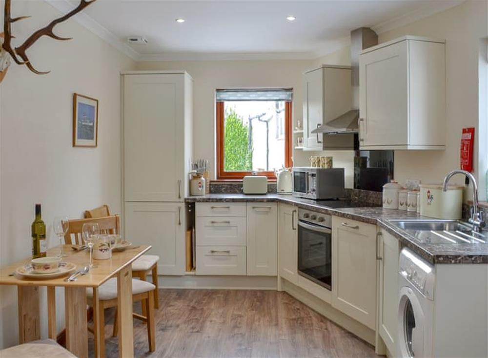 Well equipped kitchen/ dining room at Post Office Cottage in Dulnain Bridge, near Grantown-on-Spey, Morayshire