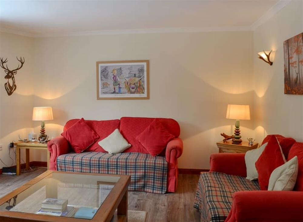 Well presented living room at Post Office Cottage in Dulnain Bridge, near Grantown-on-Spey, Morayshire