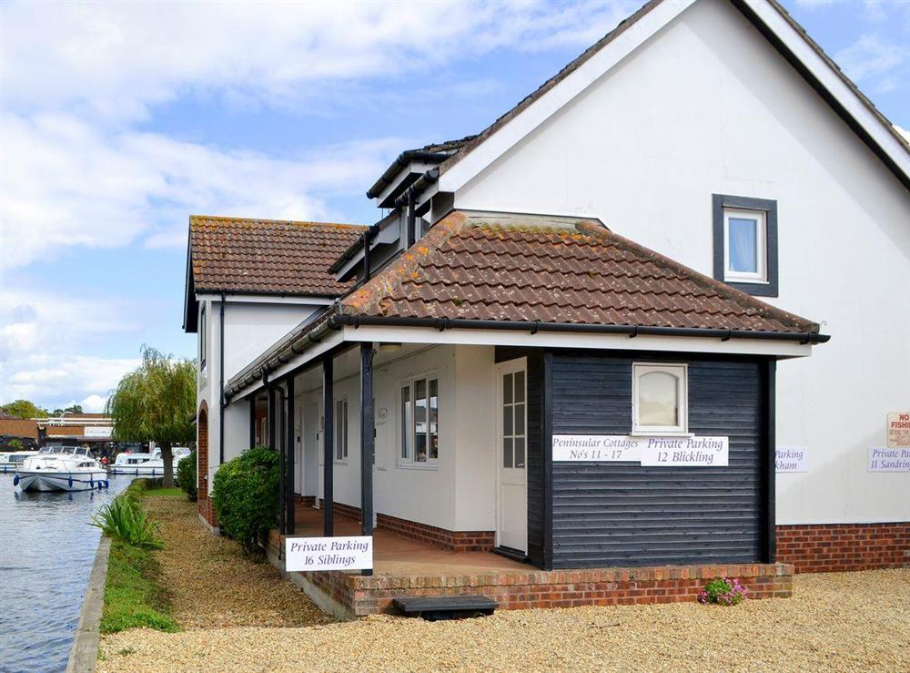 Welcoming riverside cottage entrance at Pottergate Cottage in Wroxham, Norfolk