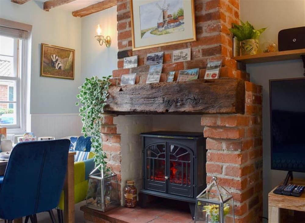 Attractive living/ dining room at Puddingmoor Cottage in Beccles, Suffolk