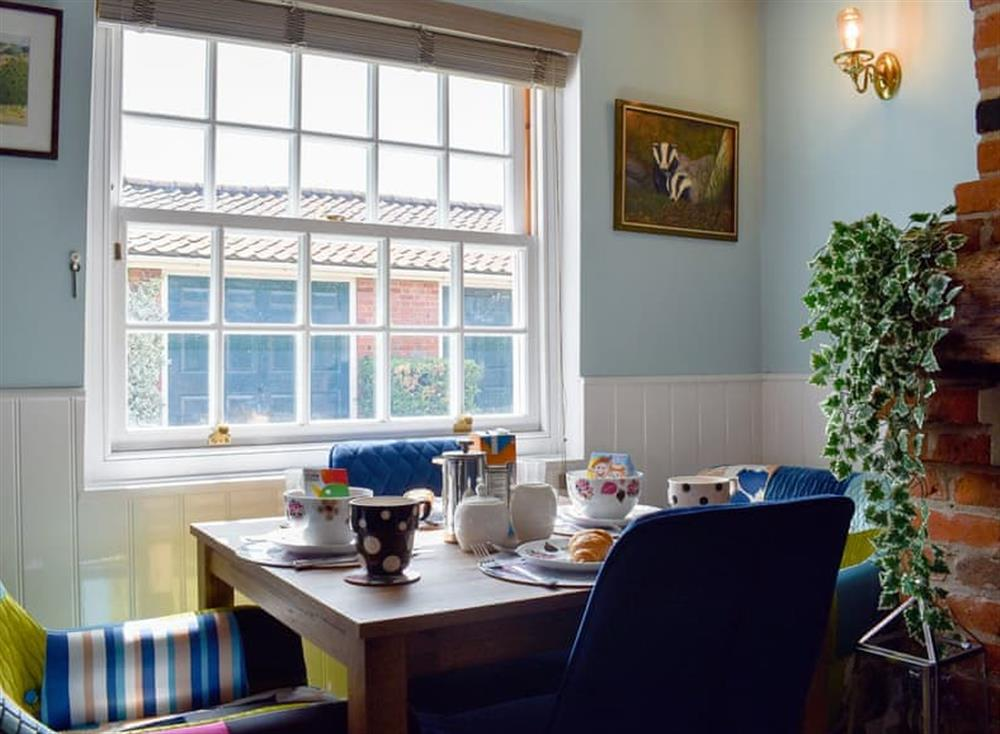 Quaint dining area at Puddingmoor Cottage in Beccles, Suffolk