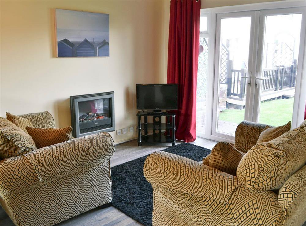 Comfortable lounge with Freeview TV at Puffin Cottage in Wroxham, Norfolk