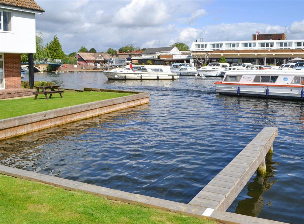 Relax and watch the boating activity along the river at Puffin Cottage in Wroxham, Norfolk