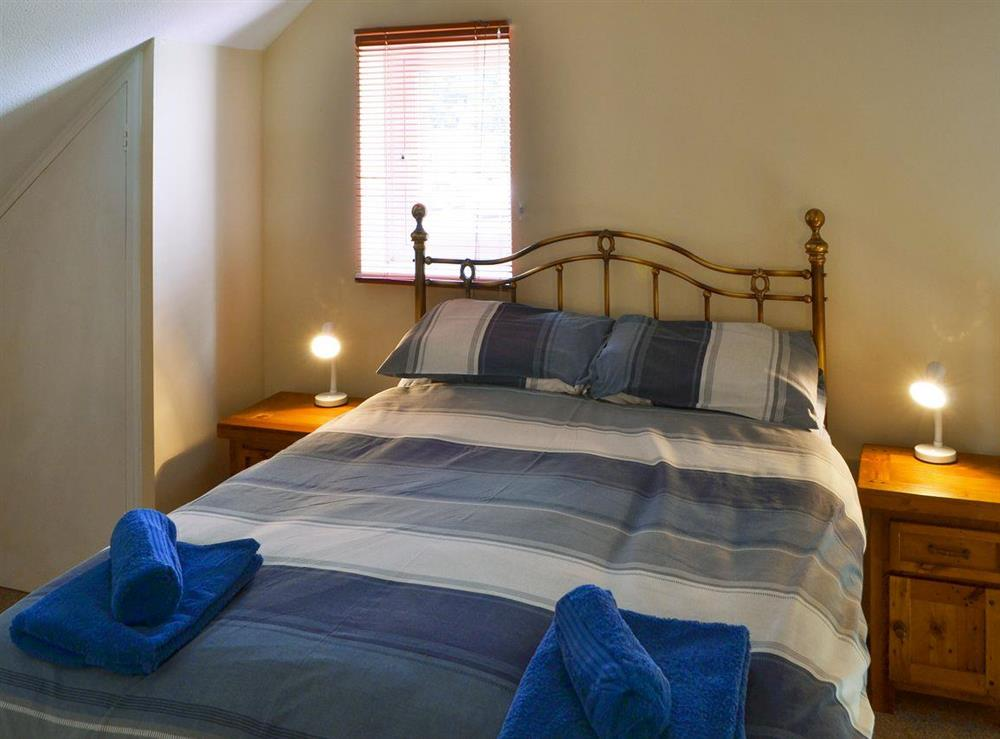 Relaxing bedroom with double bed at Puffin Cottage in Wroxham, Norfolk