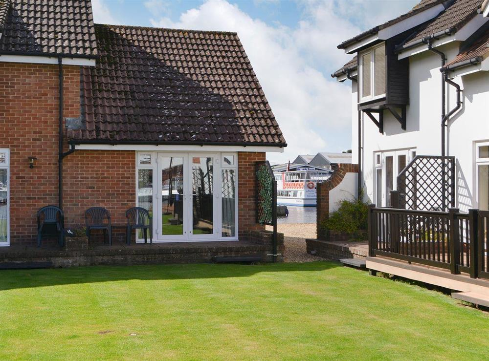 Spacious landscaped grounds at Puffin Cottage in Wroxham, Norfolk