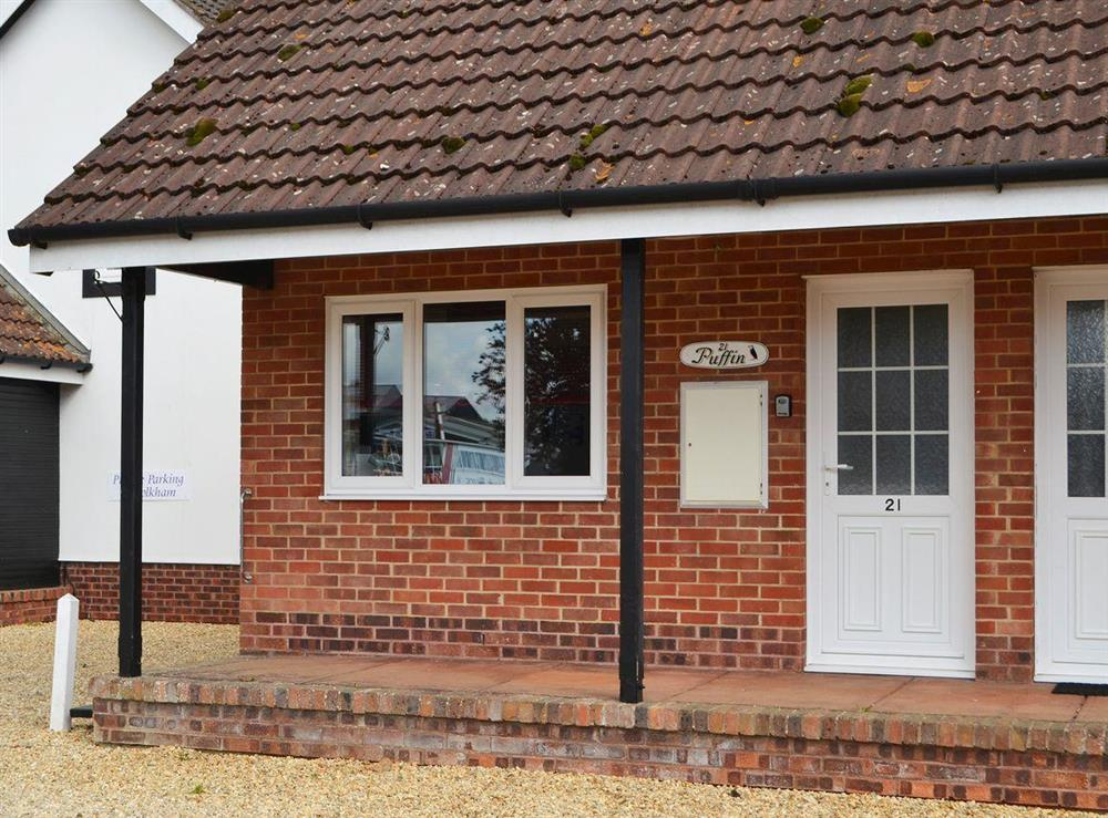 Welcoming riverside cottage entrance at Puffin Cottage in Wroxham, Norfolk