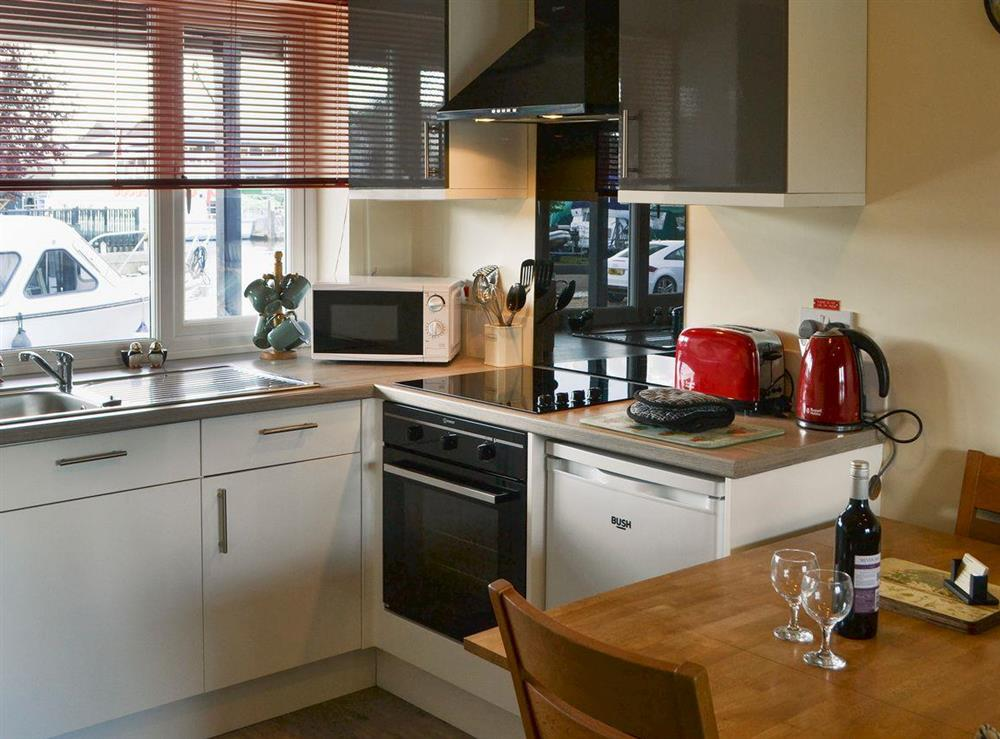 Well-equipped kitchen at Puffin Cottage in Wroxham, Norfolk
