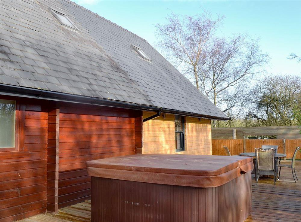 Decked out side area with hot tub at Quarry Lodge in Munsley, near Ledbury, Herefordshire