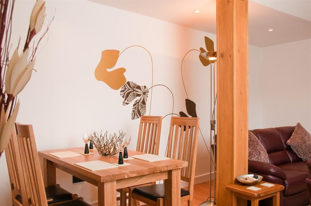 Dining area with oak table and four chairs at Quay Lodge in 60 Sandquay Road, Dartmouth