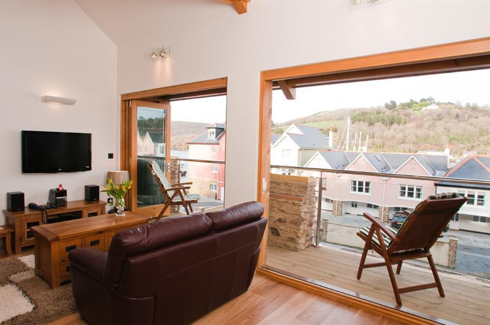 Lovely open-plan lounge area with sliding doors to balcony at Quay Lodge in 60 Sandquay Road, Dartmouth