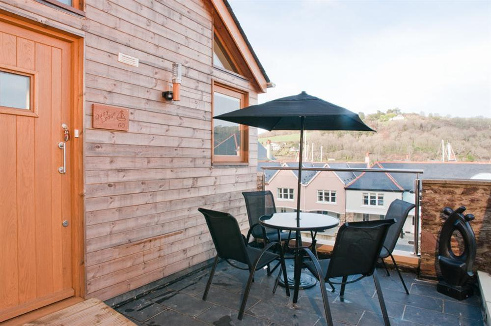 Terrace with table and chairs at Quay Lodge in 60 Sandquay Road, Dartmouth