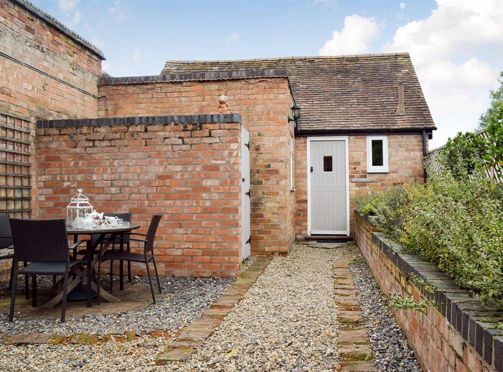 Exterior with outdoor seating area at Queens Cottage in Long Marston, near Stratford-upon-Avon, Warwickshire