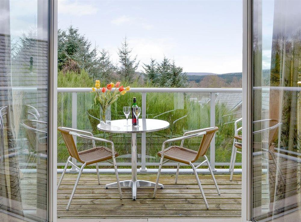 Balcony with outdoor furniture and great views at No 32,