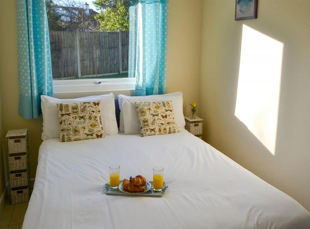 Comfortable double bedroom at Beach Therapy,
