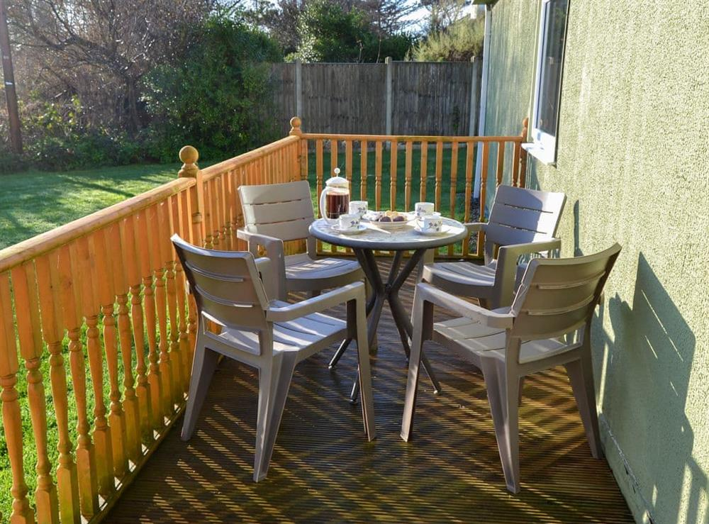 Enclosed decked veranda with garden furniture at Beach Therapy,