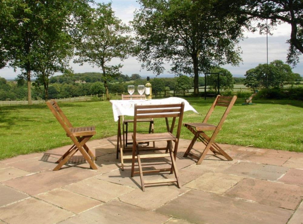 Sitting-out-area at Red House Farm Cottage in Whitegate, Cheshire., Great Britain