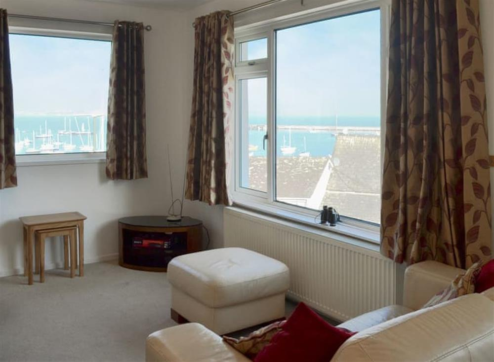 Light and airy living area with wonderful views at Red Sails in Brixham, Devon