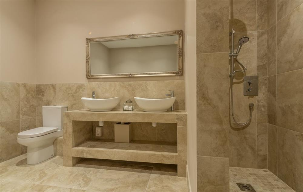 Ground floor: Master en-suite with double ended slipper bath, luxury shower, double basins, WC and heated hand rail