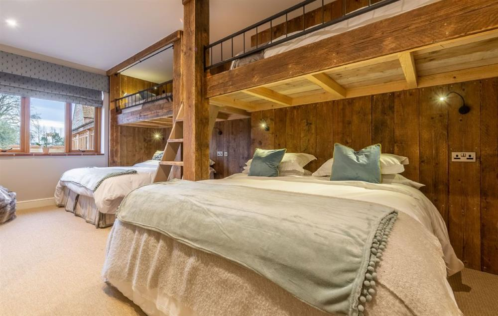 Ground floor: 'The Dorm' with chalet-style, built-in bunk complex which can either be taken with two super king beds and two single top bunks, or as six single beds
